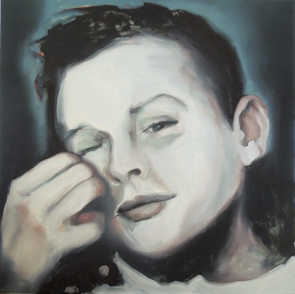 Portrait of a mischievous looking boy scratching his cheek