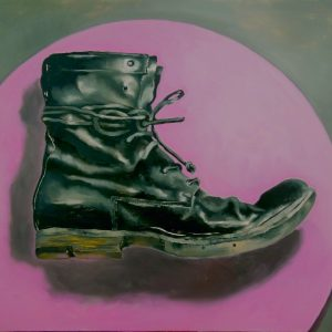 Painting of an old boot on a plum coloured disc