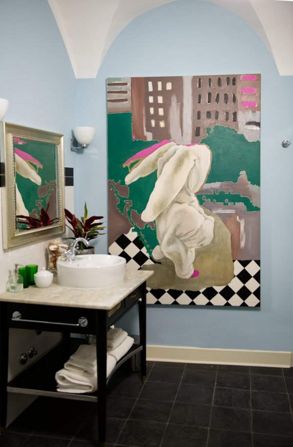 Painting Big placed in a bathroom setting