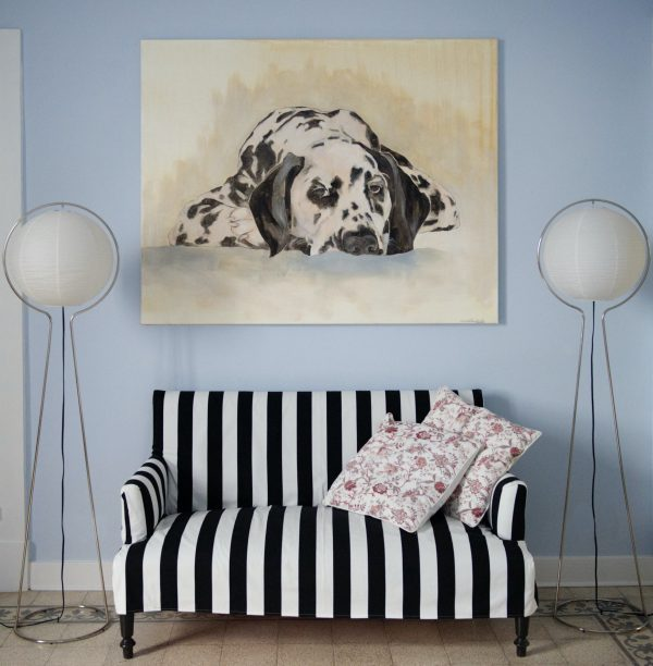 Painting It's A Dog hanging above a sofa