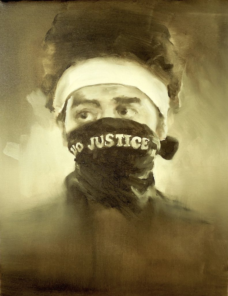 Black Lives Matter protester wearing NO JUSTICE face mask