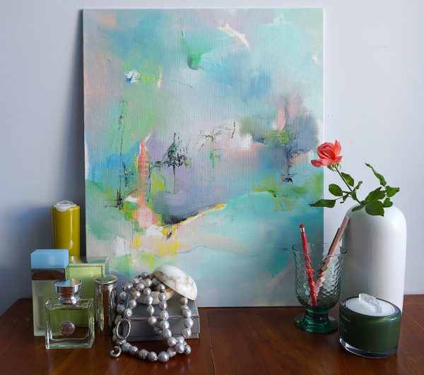 Abstract expressionist landscape oil painting Mood 56 against a wall standing on dressing table