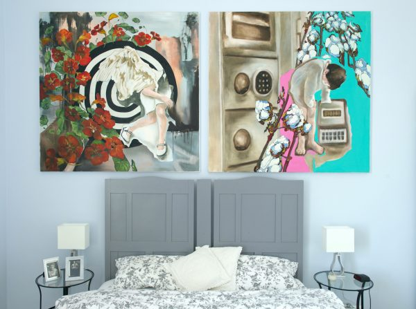 Paintings Target and Locker Room hanging in setting above king bed