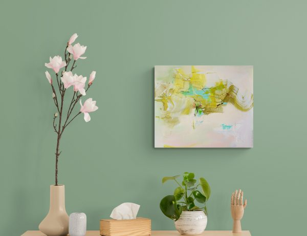 Abstract expressionist painting Silver Lining 5 hanging on green wall above wooden cabinet with plants