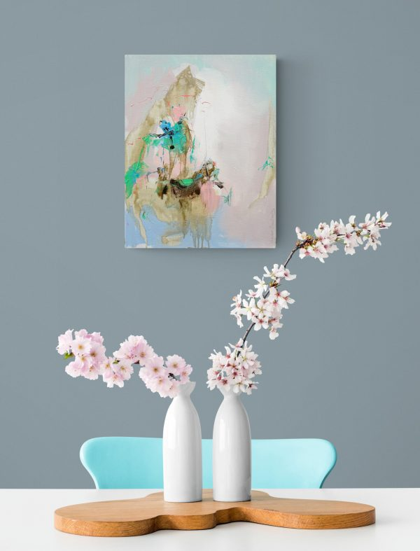 Abstract expressionist painting Mellow 10 hanging on a light coloured wall above a table with cherry blossom