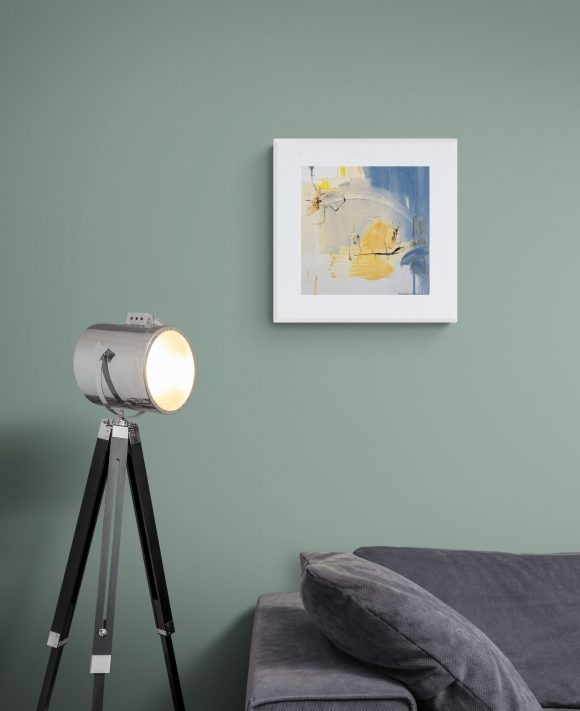 Abstract painting Mellow 29 hanging on a wall above a sofa with lamp