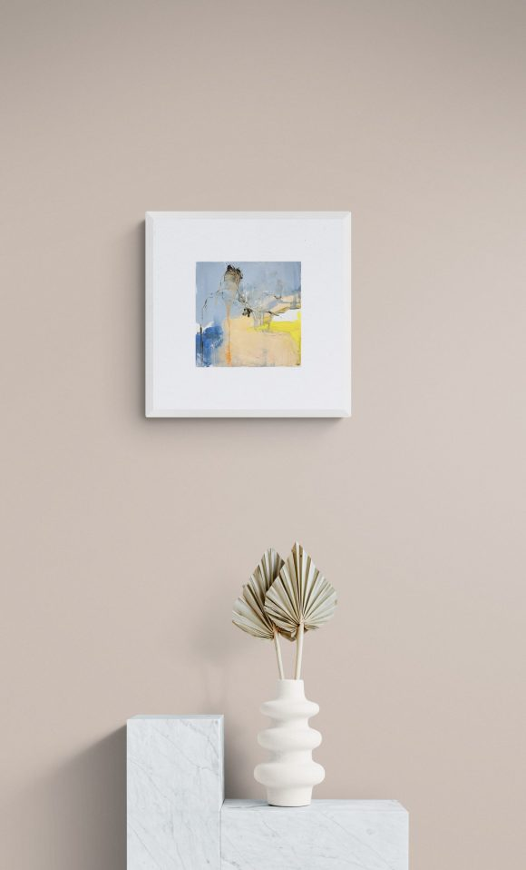 Abstract painting Mellow 30 hanging on a wall above a white wall unit