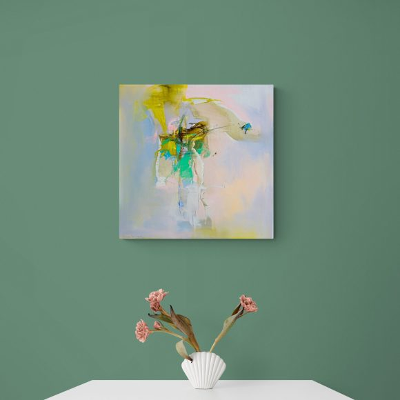 Abstract expressionist painting Mellow 12 hanging on a green wall above a table with flowers