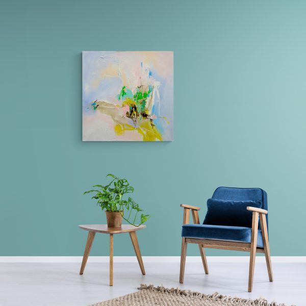 Abstract expressionist painting Mellow 13 hanging on a green/blue wall in room with trendy chair/sidetable
