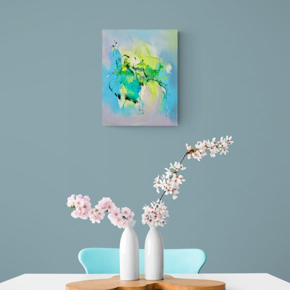 Abstract painting Mellow 19 hung on green wall above table with blossom