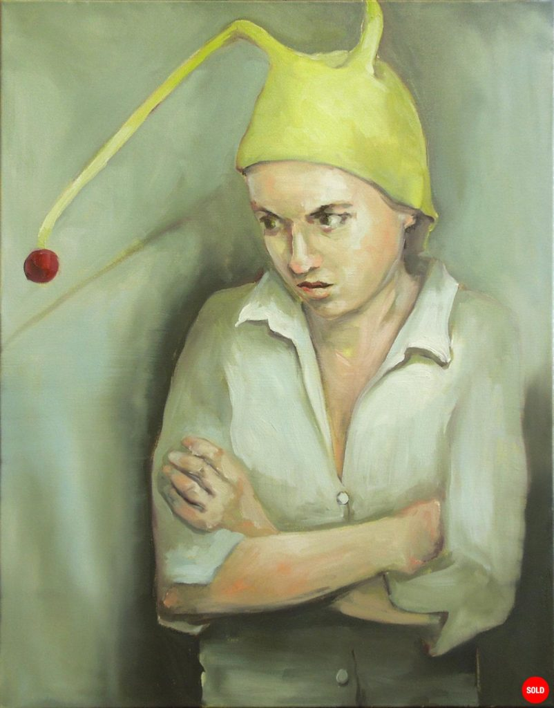 Portrait of a girl in yellow hat with red bobble
