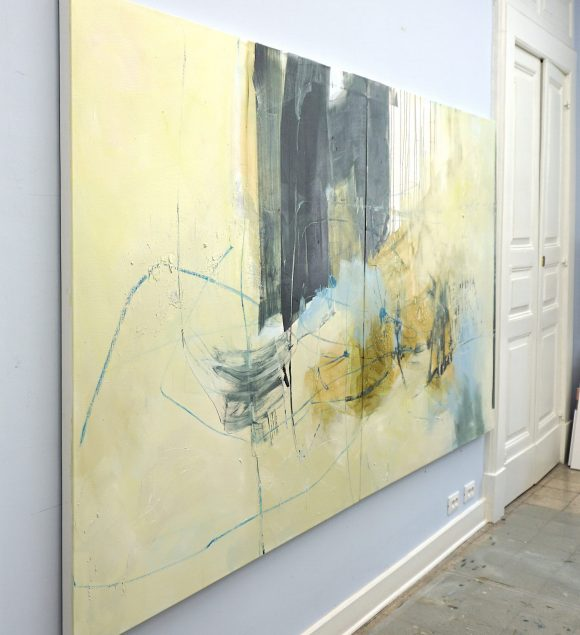 Side view of evocative abstract XL painting in light brown, dark green, blue, yellow